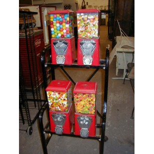 Four Head Gumball Machine on Rack